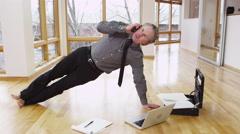 Businessman juggles yoga and work - 4K Stock Footage