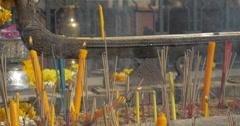 Burning incense and candles in Bangkok, Thailand Stock Footage