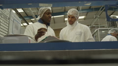 4K Workers on a production line Stock Footage