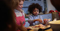Family Eating Homemade Cupcakes At Table Shot On R3D Stock Footage