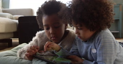 Two Children Playing With Digital Tablet At Home Shot On R3D Stock Footage