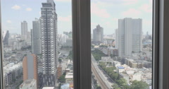 Woman in bath relaxing from big city. Window view to Bangkok, Thailand Stock Footage
