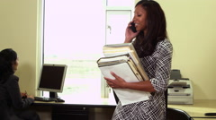 Office worker carrying files and laptop with cellphone Stock Footage