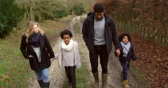 Family Walking Along Path In Countryside Shot On R3D Stock Footage