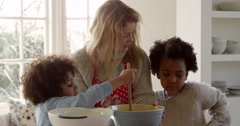 Mother And Children Baking Cake At Home Shot On R3D Stock Footage