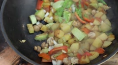 Vegetarian Stew Prepared on a Large Frying Pan Over a Fire Stock Footage