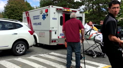 Medical team puts injured patient in ambulance and transported him to hospital. Stock Footage