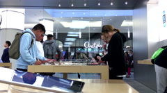 People playing ipad inside Apple store Stock Footage