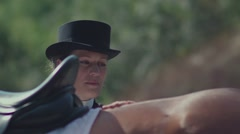 Withers horse. A woman rider in a long frock coat and hat petting horse Stock Footage