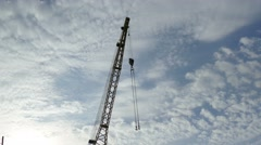 Building crane against the blue sky video Stock Footage