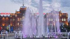 Urban landscape with a fountain on the background of the station Stock Footage