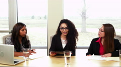 Three coworkers in an office meeting Stock Footage