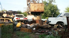 Old abandoned landfill video disposal vehicles cars Stock Footage