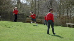 School Pupils Playing Chasing Game At Breaktime Shot On R3D Stock Footage