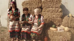 Women in Ukrainian Folk Costumes in the Hayloft in the Smoke, Traditional Food Stock Footage
