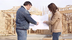 Couple holding floor plan Stock Footage
