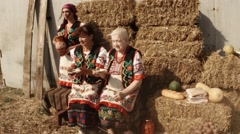 Young and Old Woman in Ukrainian Costume, Barn, Potatoes, a Pitcher of Milk, Stock Footage