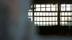 Glass silhouette sunlight house window abandoned warehouse video factory broken Stock Footage