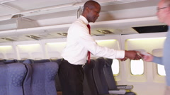 Passengers talking to flight attendant Stock Footage