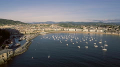 Aerial Above the Boats with San Sebastian Skyline and Boulevard, Spain Stock Footage
