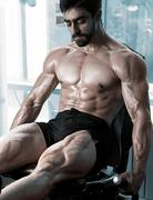 Strong bodybuilder training quads Stock Photos