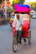 Cycle rickshaw carrying goods at Johari Bazaar street in Jaipur, Rajasthan, I Stock Photos