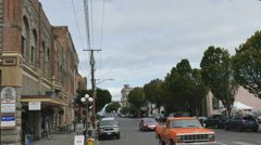 Labor Day vehicle pedestrian traffic Water Street Port Townsend, Washington Stock Footage