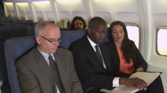 Business travelers on plane Stock Footage