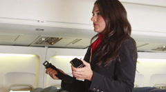 Flight attendant instructing safety procedures Stock Footage