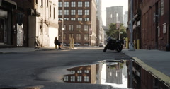 Brooklyn Bridge reflected in a puddle - DUMBO - 4k Stock Footage