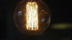 Vintage filament Edison light bulb. Stock Footage