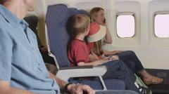 Family using cellphone on plane Stock Footage