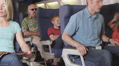 Annoying child on plane Stock Footage