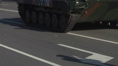 Military Tank driving in a city road Stock Footage