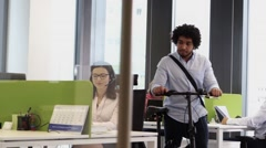 Employee with bicycle saying goodbye when leaving office at 5 pm Stock Footage