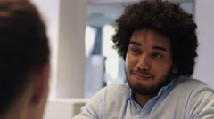 Middle Eastern Man having a conversation with female colleague in office Stock Footage