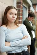 Portrait Of Unhappy Teenage Couple In Urban Setting Stock Photos