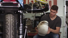Portrait of man working on motorcycle Stock Footage