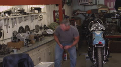 Man looking for automobile parts Stock Footage