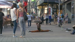4K African artists performing acrobatic downtown shopping district Essen NRW Stock Footage
