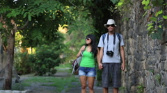 A couple walk around as tourists and take pictures, in Brazil Stock Footage