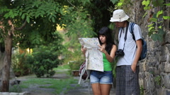 A couple on vacation in Brasil look at a map to orient themselves Stock Footage