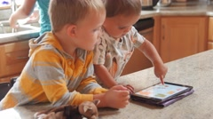 Dolly shot of boys playing with iPad at home Stock Footage