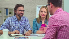 CEO Explaining Financial Situation to Coworkers Stock Footage