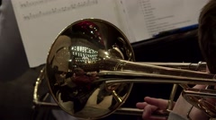 Playing the trombone in a symphony orchestra (rehearsal). Stock Footage