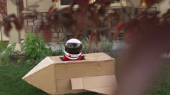 Little boy pretending to be astronaut Stock Footage