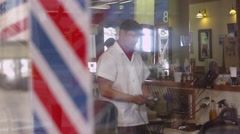 View of barber inside shop Stock Footage