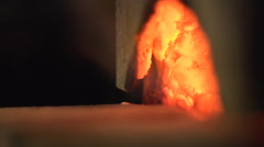 Putting Steel in Forge Oven Stock Footage