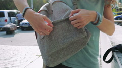 Girl closes the zipper pocket on the backpack Stock Footage