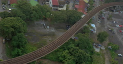 Railway with a passing train in city of Kuala Lumpur, Malaysia Stock Footage